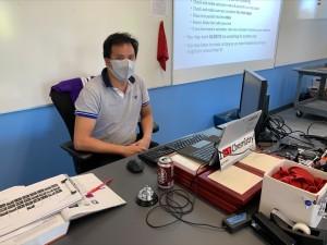 Mr. Cheng at his desk